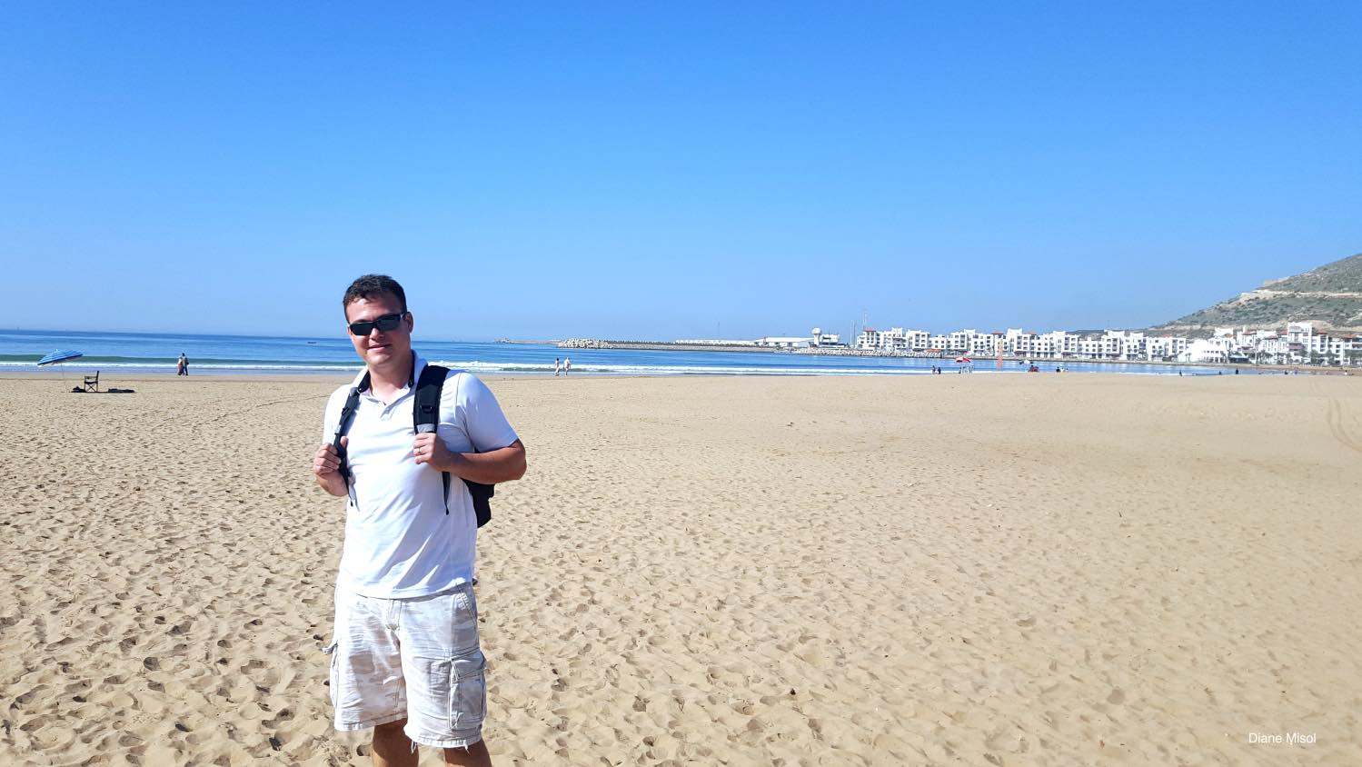 Tourist checking out Agadir Beach, Morocco