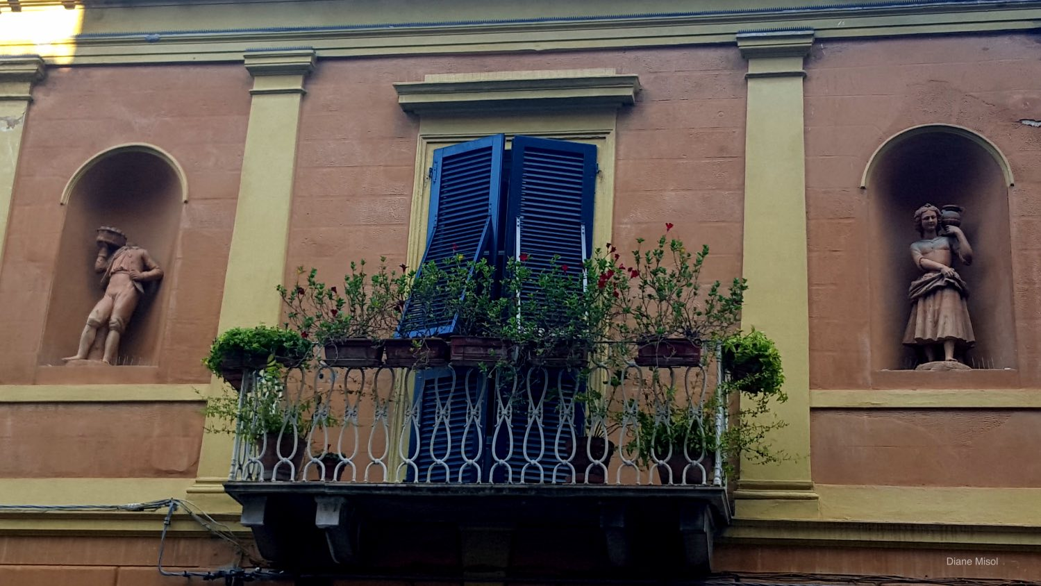 A Balcony with side Statuettes in Pisa, Italy