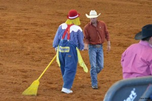 Rodeo Clown shakes hands with cowboy
