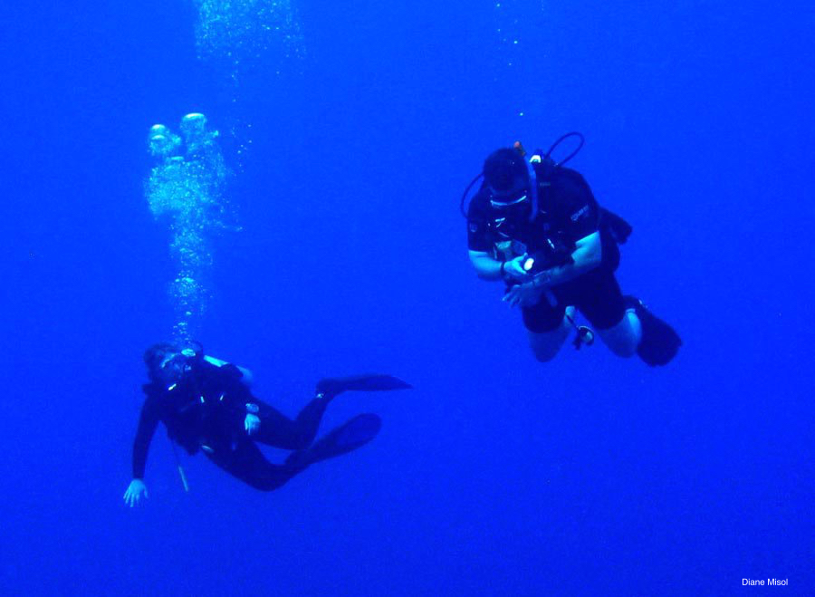 two divers in Maldives blue water