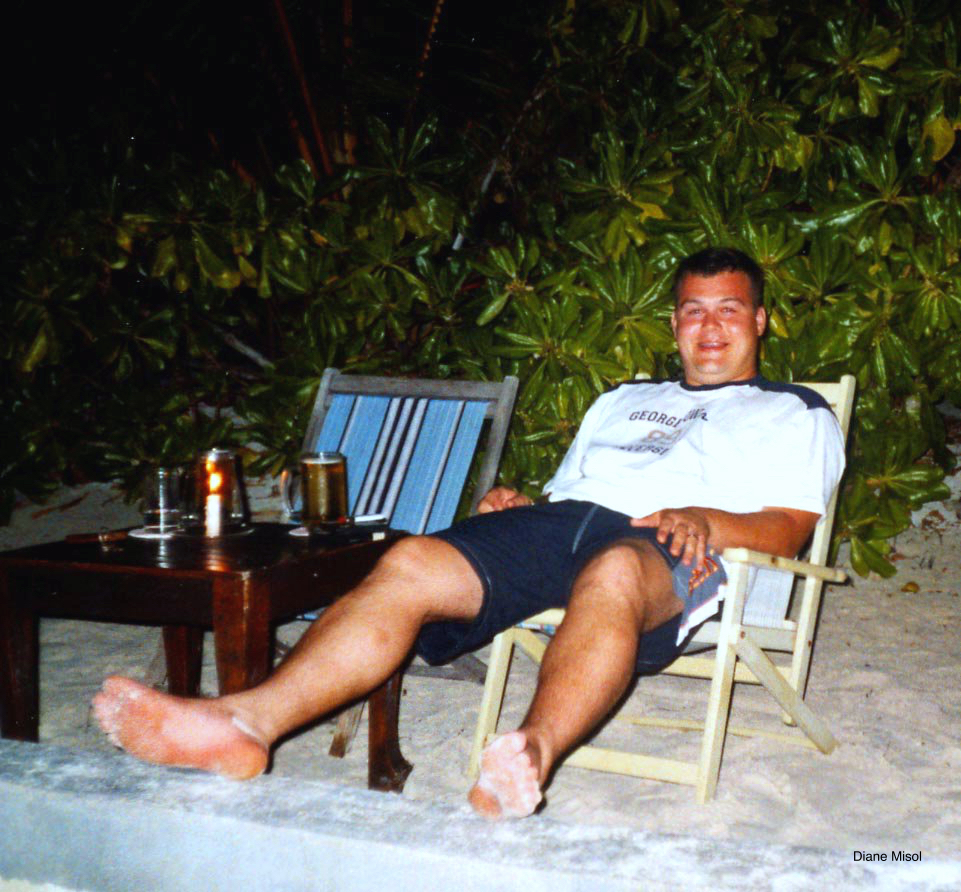 Man relaxes at night on beach