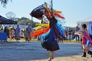 Native American dancing followed by child