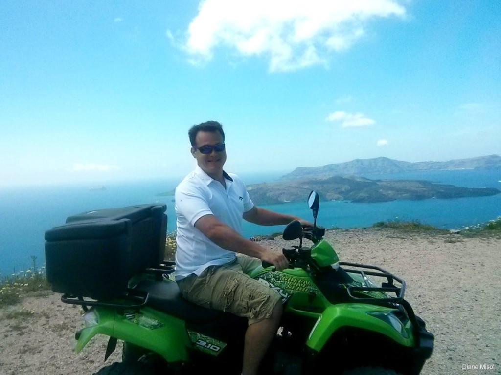 Man on ATV, Santorini, Greece
