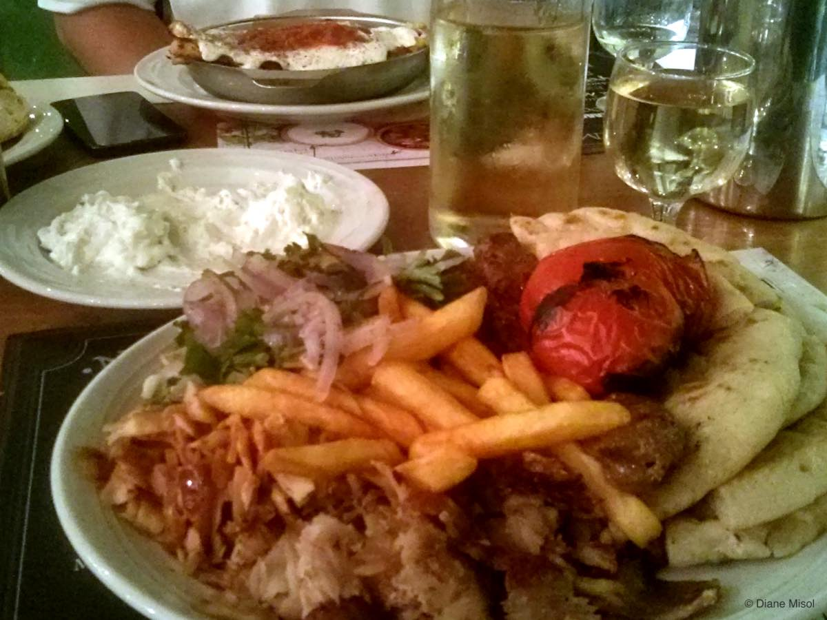 Gyro Platter with Grilled Tomatoes, and Moussaka. Athens, Greece