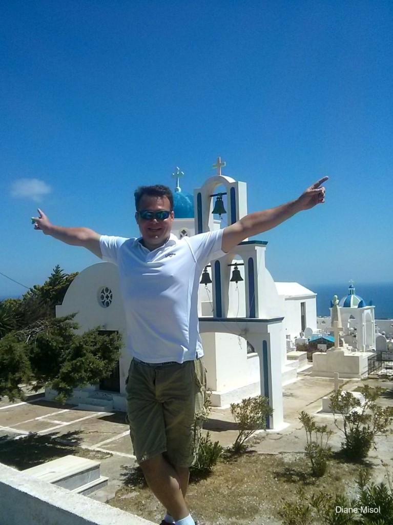 Tourist in front of a Santorini Bell Tower, Opa!