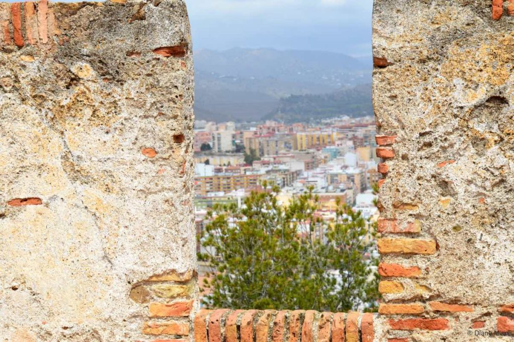 Peaking through Fortress Walls. Malaga, Spain