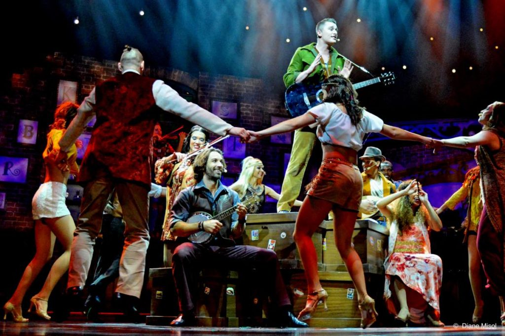 Instruments and Dance. Broken Strings - A Cruising Musical Success