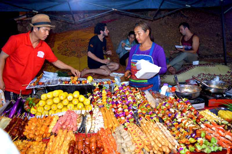 Backpackers Enjoy the Night Market Food - Luang Prabang, Laos