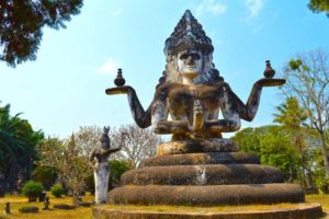 Four Armed Lady, Prayer and Offerings - Buddha Park, Vientiane, Laos