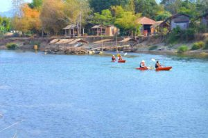 Kayakers on Nam Song River - Vang Vieng, Laos