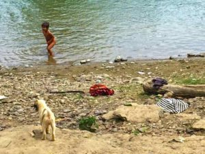 Laotian Child Plays in River - Vang Vieng, Laos