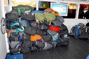Backpacks Loaded at the Front of Lompraya Boat, Inside - Thailand