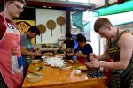 Cooking Students Concentrate on Pounding Curry Paste - Chiang Mai