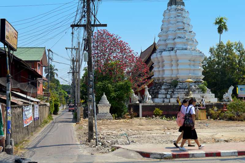 School Girls Pass by Wat Muentoom - Chiang Mai, Thailand